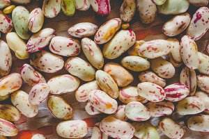 Crimson beans vegetables background, faded vintage look