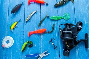 Fishing reel, fishing line, pliers. Fishing lures.