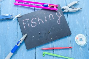 Fisherman's tools. Fishing composition. Fishing abstraction. Decorative background. Copyspace.