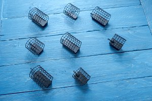 The composition of the fishing feeders. Decorative background. Fishing accessories. Top view.