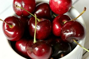 Cherries in white bowl - macro