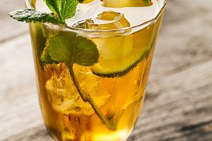 Tasty cold drink with lime and mint