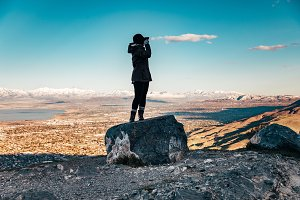Girl High on a Rock