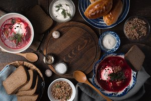 Dishes of traditional Russian cuisine on the wooden table top view