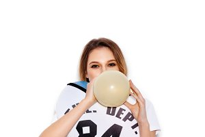 girl playing with colorfull latex balloons