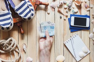 Striped espadrilles, money, passports and marine decorations