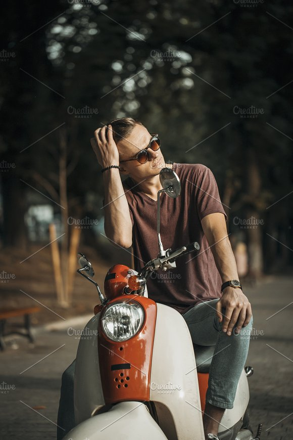 Portrait Of Young Man On Motorbike