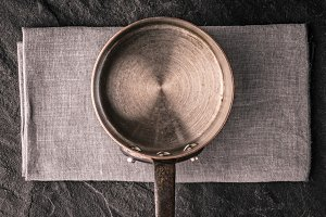 Metal pan on the stone