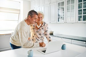 Couple of elderly people using a laptop