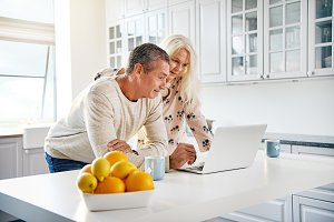 Healthy happy retired couple browsing the internet