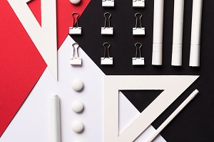 Office supplies on the white red and black background table