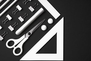 Office supplies on the black background table