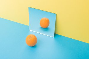 Grapefruit on blue table isolated over yellow background