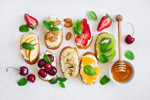 set summer sweet snacks. Bruschetta or sandwiches with fruit and