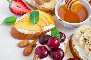 selection summer sweet snacks. Bruschetta or sandwiches with fru