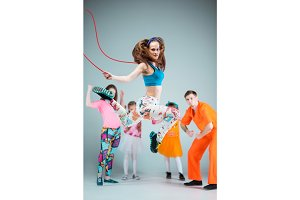 Group of man, woman and teens dancing hip hop choreography