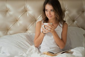 Cute girl sitting with a cup of coffee