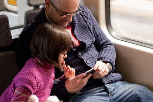 Father and daughter on train.jpg
