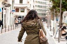 Woman cycling down the street.jpg