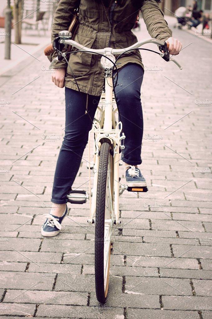Woman on retro bike.jpg - Transportation