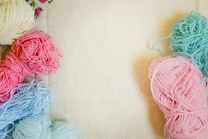 Colored yarn on a textile background