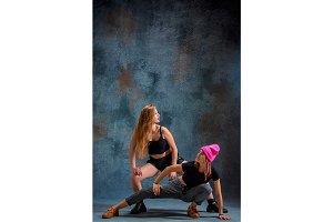 The two attractive girls dancing twerk in the studio
