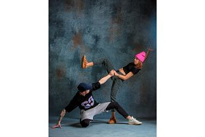 The two young girl and boy dancing hip hop in the studio