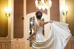 Woman raises her long dress up