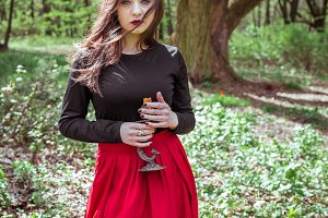 witch in the woods with a candle