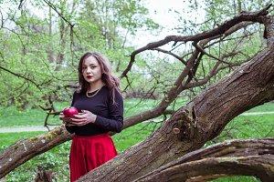 girl standing near a tree trunk