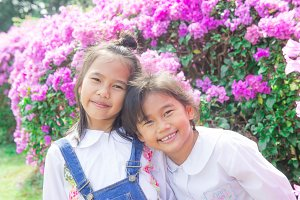 Two little Asian girls smiling