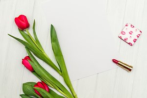 red tulips on a white wooden board