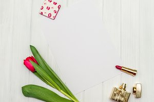 red tulip on a white wooden board