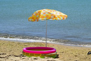 Beach umbrella from the sun on the beach. Black Sea.