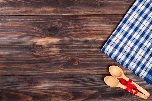 blue checkered tablecloth on the black wooden table with copy space for your text. Top view