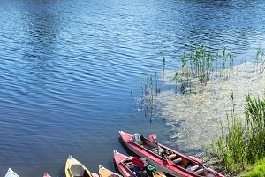 Canoes on a river-bank.