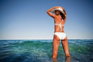 Young woman in white swimsuit