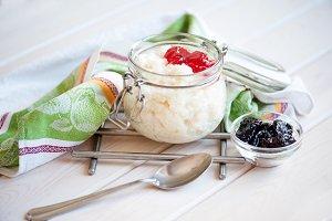 Milk rice porridge with jam.