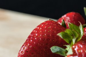 Beautiful strawberries on the wooden