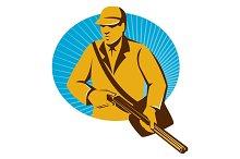 hunter hunting with shotgun rifle re