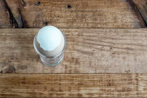 Boiled egg on wooden board