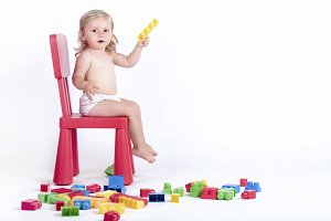 Baby with colorful blocks