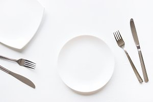 two empty plates and cutlery mockup