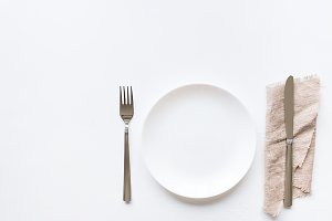plate and cutlery on a napkin