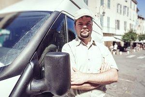 Messenger Standing Next To His Van