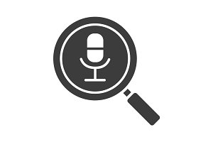 Magnifying glass with microphone glyph icon