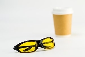 Sunglasses with yellow lenses on a white background