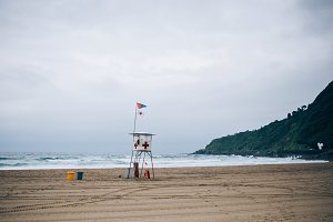High hazard sign and lifeguard tower
