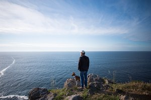Man and his dog overlook cliffs