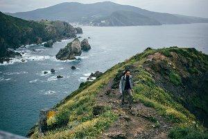 Man hikes through mountains